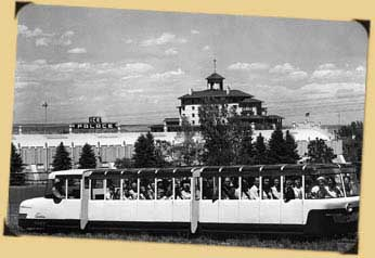Mountaineer Train ready to bring passengers up to the Zoo, parked in front of The Broadmoor Hotel