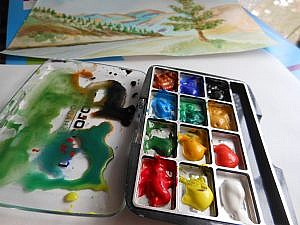 Watercolor paints open and ready to use on pallette