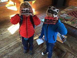 School break kindergarten camp two campers with racoon masks