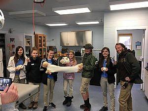 Winter Teen Core participants holding large bones during vet hospital visit
